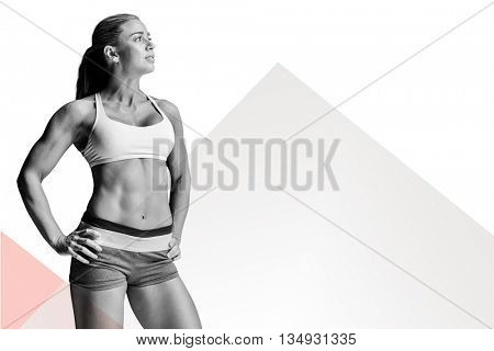 Female athlete posing with hands on hip against rosa beige and white