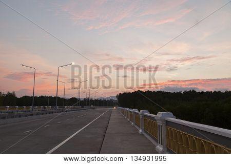 bridge evening and light poles in the evening.