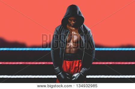 Boxer posing after failure against blurred mountains