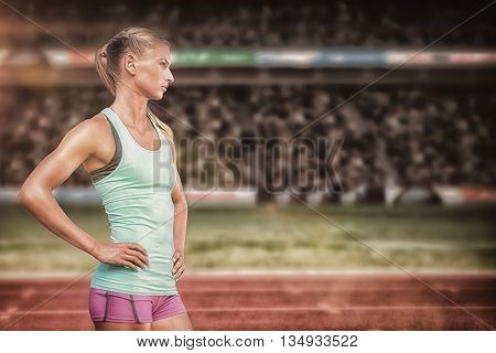 Profile view of sportswoman standing on a white background against view of a stadium