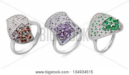 Close-up On Three Silver Rings Of Different Shapes