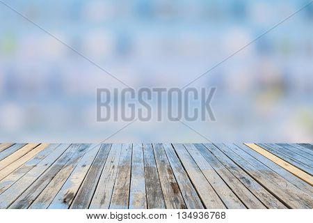 Wood floor on abstract blur background with blurry bokeh defocused lights.