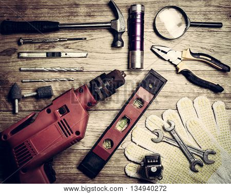 Set Of Tools Over A Wood Background