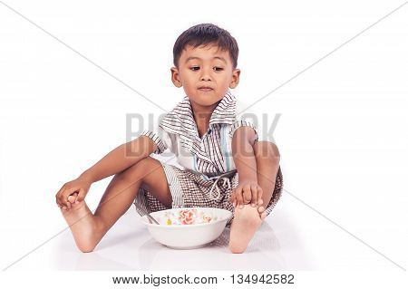Cute little boy anorexia on white background