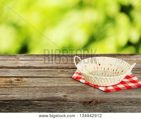 Background with wooden table with basket, close up