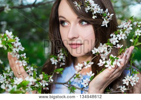 Close Up Portrait Of Beautiful Woman In Blooming Cherry Garden