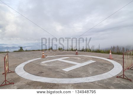 helicopter park symbol landing pad on mountain in bad weather day