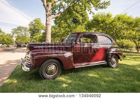 DEARBORN MI/USA - JUNE 18 2016: A 1946 Ford Super Deluxe car at The Henry Ford (THF) Motor Muster car show, held at Greenfield Village, near Detroit, Michigan.