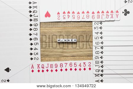 winner text inside border made of play card