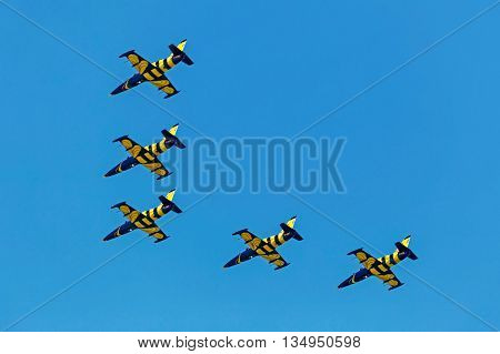 TIMISOARA ROMANIA - MAY 21 2016: Fighter jets in a local air show organised by the international airport Timisoara. Baltic Bees team.