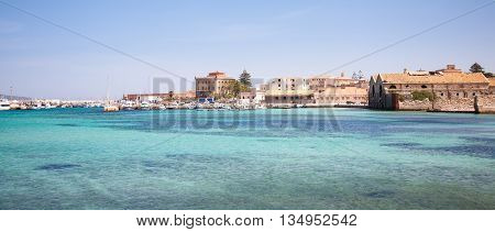 The harbour of the town of Favignana with the Villa Florio on the background Sicily Italy
