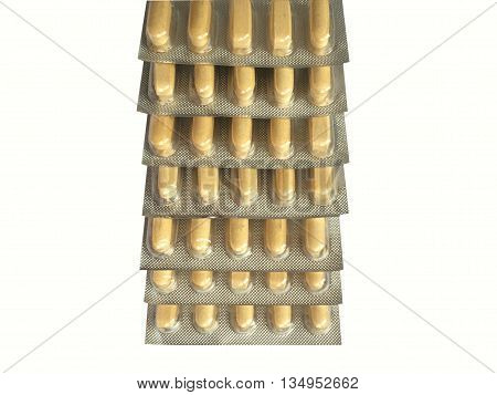 High angle shot of yellow medication blister stack isolated on white background (clipping path included)