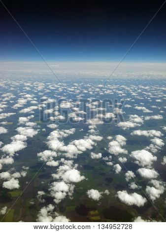 Land, clouds and space viewed from the plane