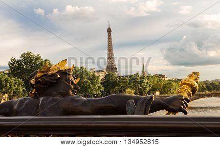 View on Eiffel tower from bridge Alexandre III Paris France.