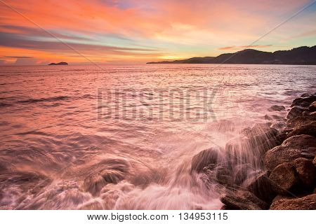 Seascape wave and beach sunset of George Town, Penang