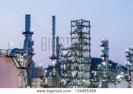 Oil Industry Refinery Factory At Sunset, Petroleum