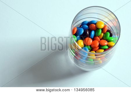 Pile of colorful sweet bonbons in glass