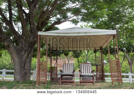 relax two chairs in party tent for picnic in garden