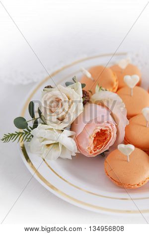 Cakes and boutonniere with roses close up