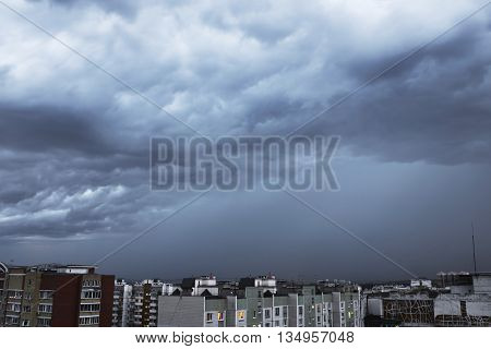 Dark And Powerful Storm Clouds Over The City. Heavy Rain, Night Shot.