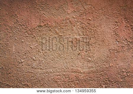 Red terra-cotta grunge horizontal background texture closeup.