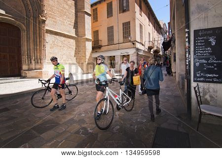 Bicyclists In Old Town