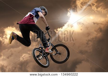 extreme sport bmx jump against the sky