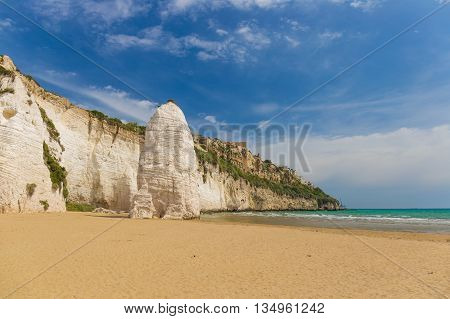 Golden Sand Beach Of Vieste With Pizzomunno Rock, Gargano Peninsula, Apulia, South Of Italy