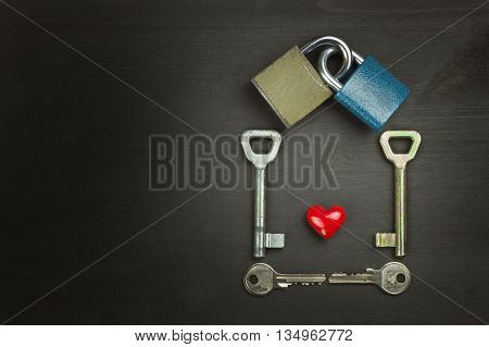 Locks and keys on a wooden table. New Symbol of love and happiness. Lock and heart. Key to the heart. Locked love. Harmony of souls.