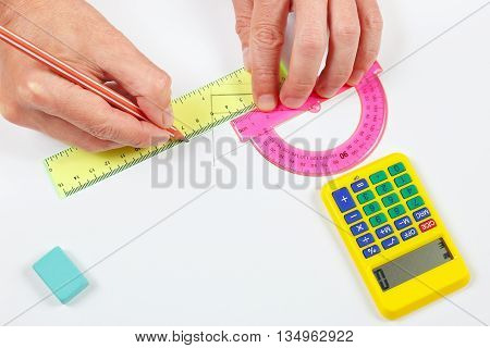 Architect hands at work with a pencil and ruler on a white sheet of paper