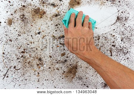 Hand with cloth wiping a dirty surface