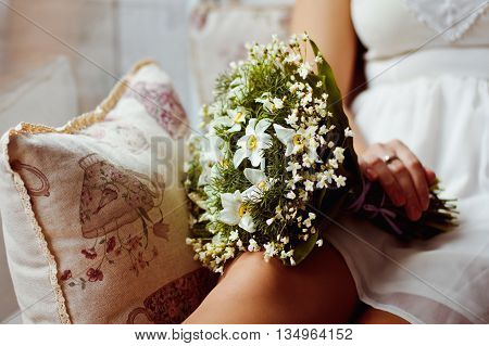 Beautiful and original bouquet of flowers in the hands of the girls