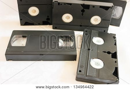 Set of old videotapes on a white background