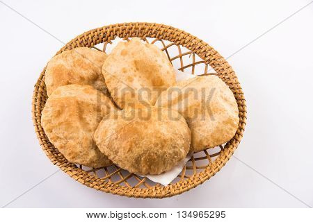 indian puri or poori or fried roti or bhatura, isolated