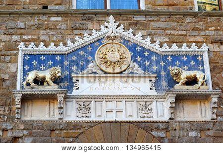 marble decorative pediment above the main portal of the Palazzo Vecchio, Piazza della Signoria in Florence, Italy