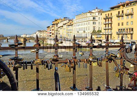 padlocks on the Ponte Vecchio, symbolizing everlasting love in Florence, Italy
