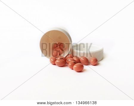 Jar of pills isolated on white background