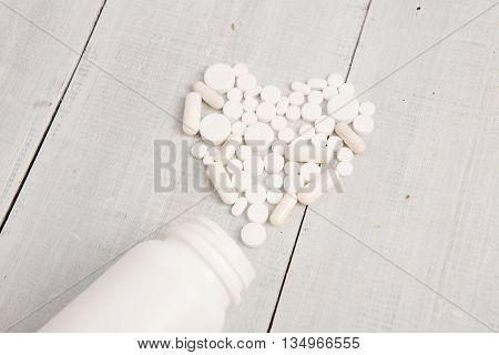 Medical Concept - White Heart Of Pills And Capsules
