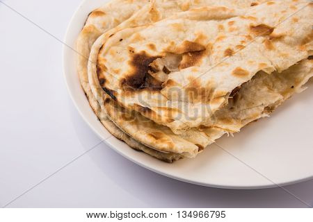 Homemade Indian Naan Flatbread made with Whole Wheat, plain indian roti, plain tandoori roti