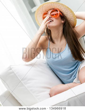 Trendy Young Woman In A Sunhat And Sunglasses