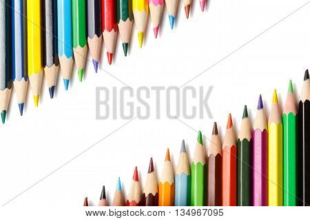 colored pencils isolated on white background lying in opposite corners