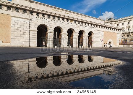 VIENNA AUSTRIA - 12TH JUNE 2016: The outside of a gate leading towards the Austrian National Library and Hofburg Palace. People can be seen.
