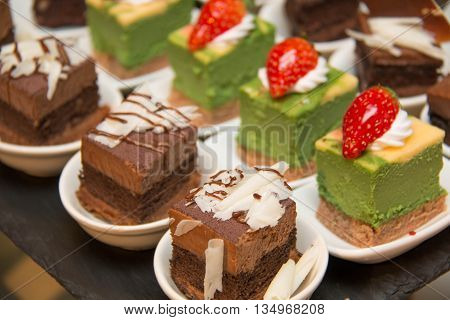 Appetizers mini desserts on catering buffet on white cup