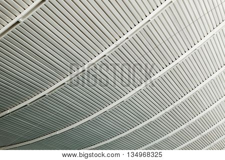 Background made of curved strips of grey metal structures