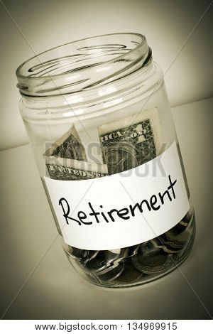 Retirement Funds And Savings Concept With Money Jar