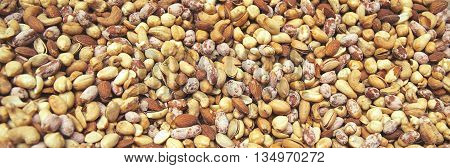 Background from mixture close-up dried pistachios cashews almonds and hazelnut