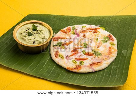 south indian food uttapam with coconut chutney, complete south indian meal
