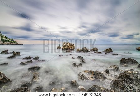 France, Nice, Cote d'Azur - Long time exposure shot made from the rocks on the beach