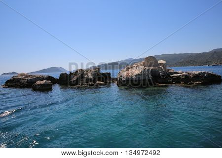 Stone foundations in the sea with steps to the water. Place for swimming and sunbathing.
