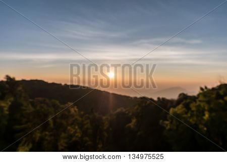 Defocused mountain sunrise at viewpoint of Kio Mae Pan Chiang Mai Thailand